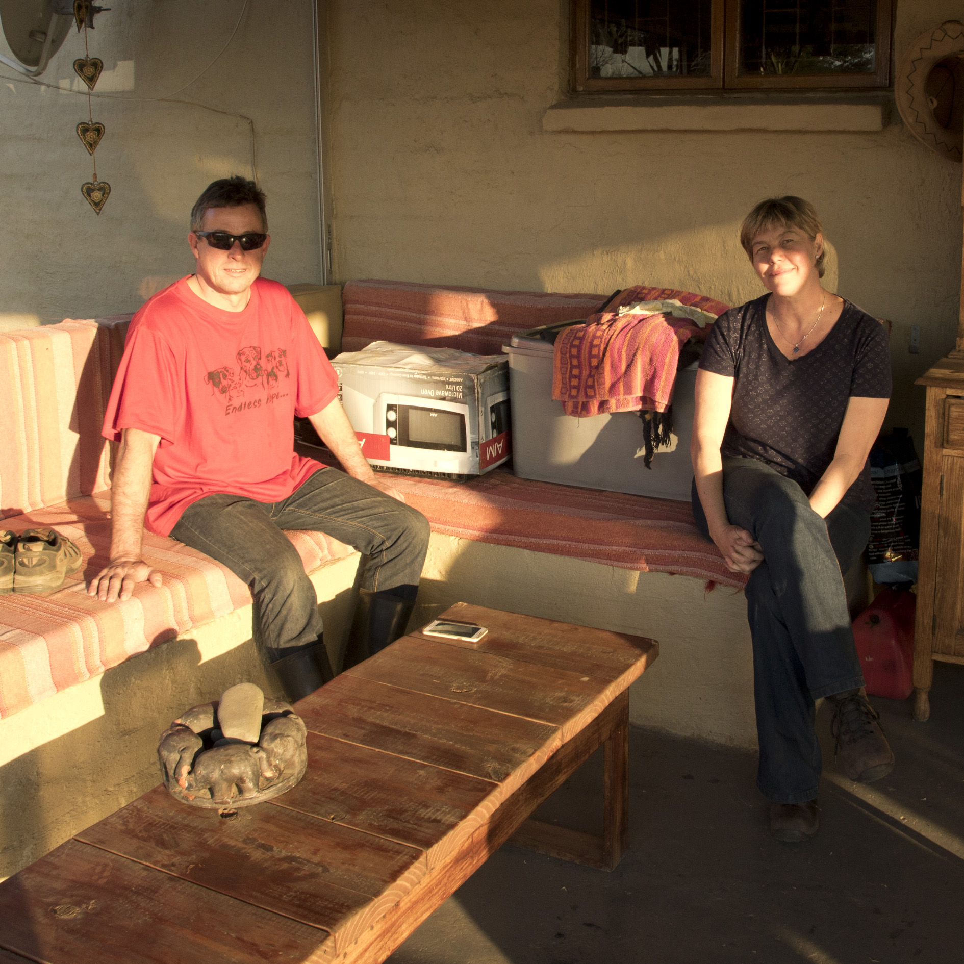 Jaco and Sofia Combrink sitting next to the owl chicks in the boxes